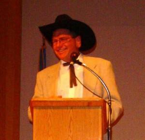 JFM at podium