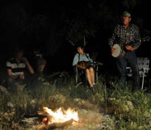 John and Kris Erickson perform by campfire light