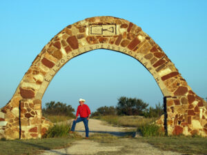 Under the stone archway entrance to Renderbrook Spade Ranch, south of Colorado City, Texas