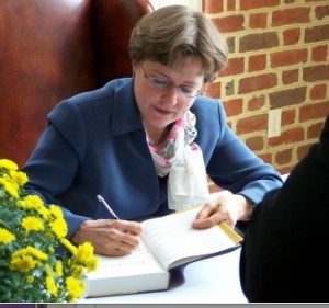 Nancy Pearcey signing a copy of Total Truth.