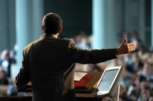 Preacher at high tech pulpit